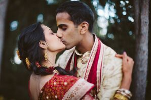 Groom Embraces his Bride in a Romantic Kiss