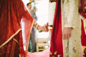 Indian Bride and Groom Hold a Leaf in their Hands During Ceremony