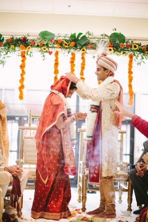 Groom Performs Ceremonial Rituals with Bride