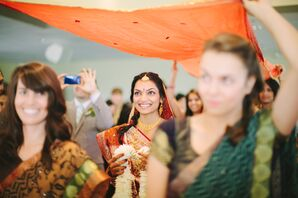 Indian Bride Processes Down the Isle Under Canopy