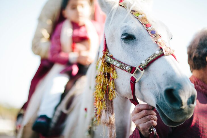 A horse transports the groom with a young boy to the ceremony.