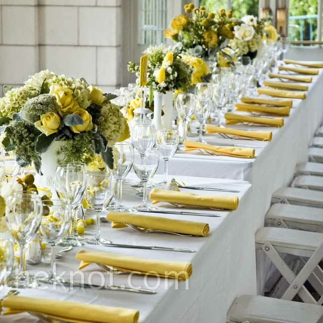 Yellow napkins and green-and-yellow centerpieces popped against the white reception table linens.