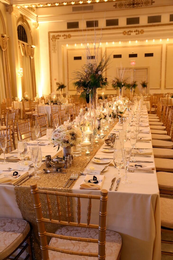 The reception took place inside the ballroom at The Westin Columbus in Columbus, Ohio, where the walls and ceilings were intricately decorated with white and gold details. The dining table linens complemented the look of the ballroom interior, dressed in white tablecloths with gold runners draped down the middle.