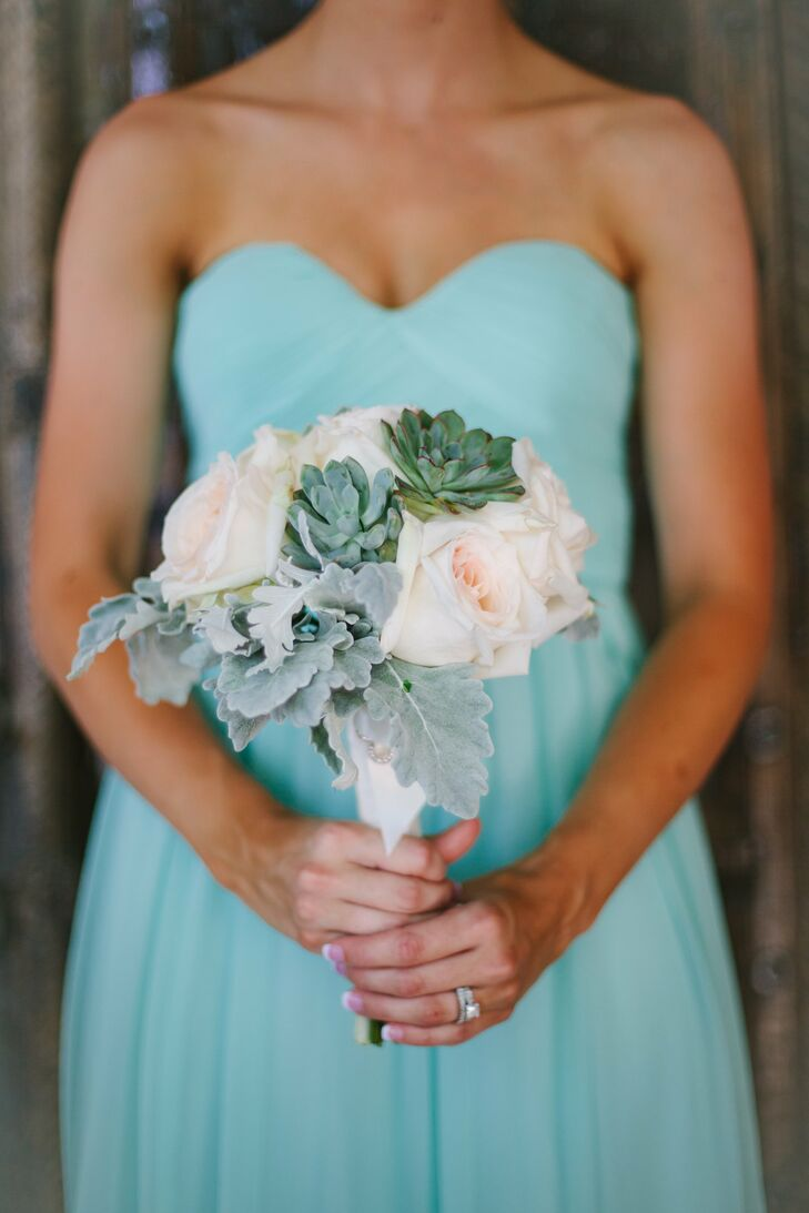 The maids carried bouquets of peach roses with succulents and dusty miller for added texture.