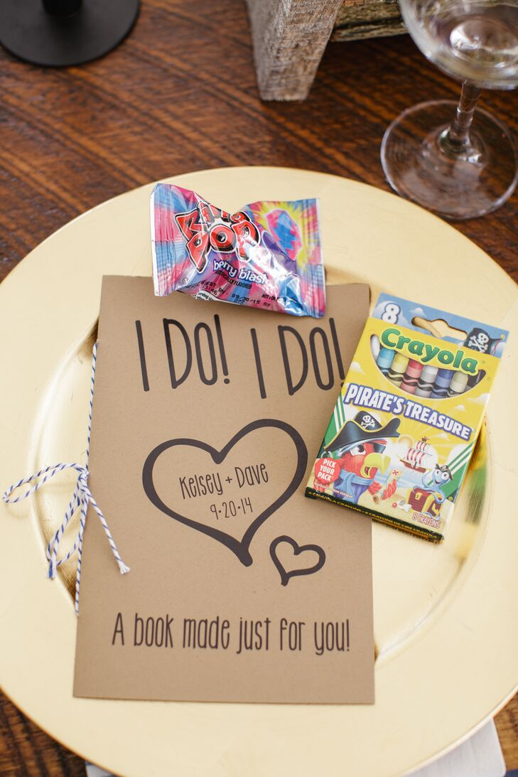 Activity books, crayons, and Ring Pop candy were given to each guest as fun, whimsical favors.