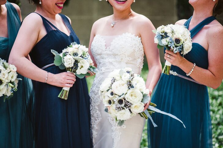 Lydia's bouquet consisted of white garden roses, white ranunculus, white lisianthus and white anemones accented with silver brunia berries, light blue delphinium and silvery dusty miller leaves. Stems were wrapped in blue silk ribbon. The bridesmaids carried petite bouquets of white lisianthus, white anemones, white majolica and blue viburnum berries accented with dusty miller.