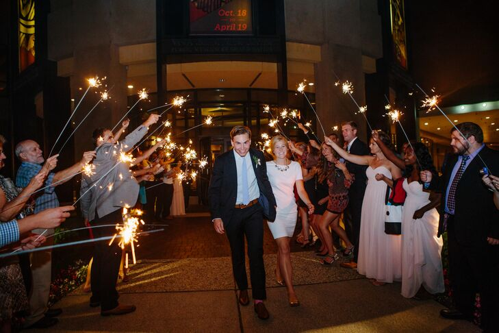 The couple left their museum reception to guests holding sparklers above them.