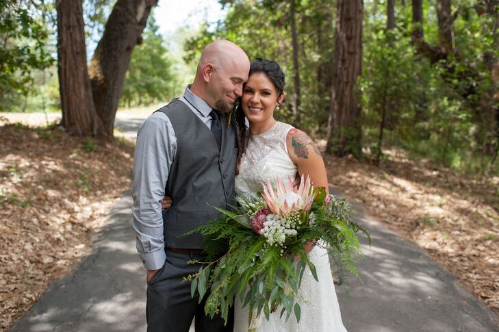 "Victoria's sequined gown was a stunning contrast to the rustic setting, and was complemented by David's neutral gray slacks and vest. ""I have a special place in my heart for this space,"" says Victoria, who grew up nearby."