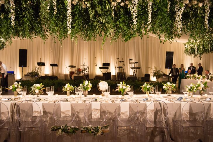 Hanging greenery and soft lighting created and ultra-romantic ambiance for the tented evening reception.
