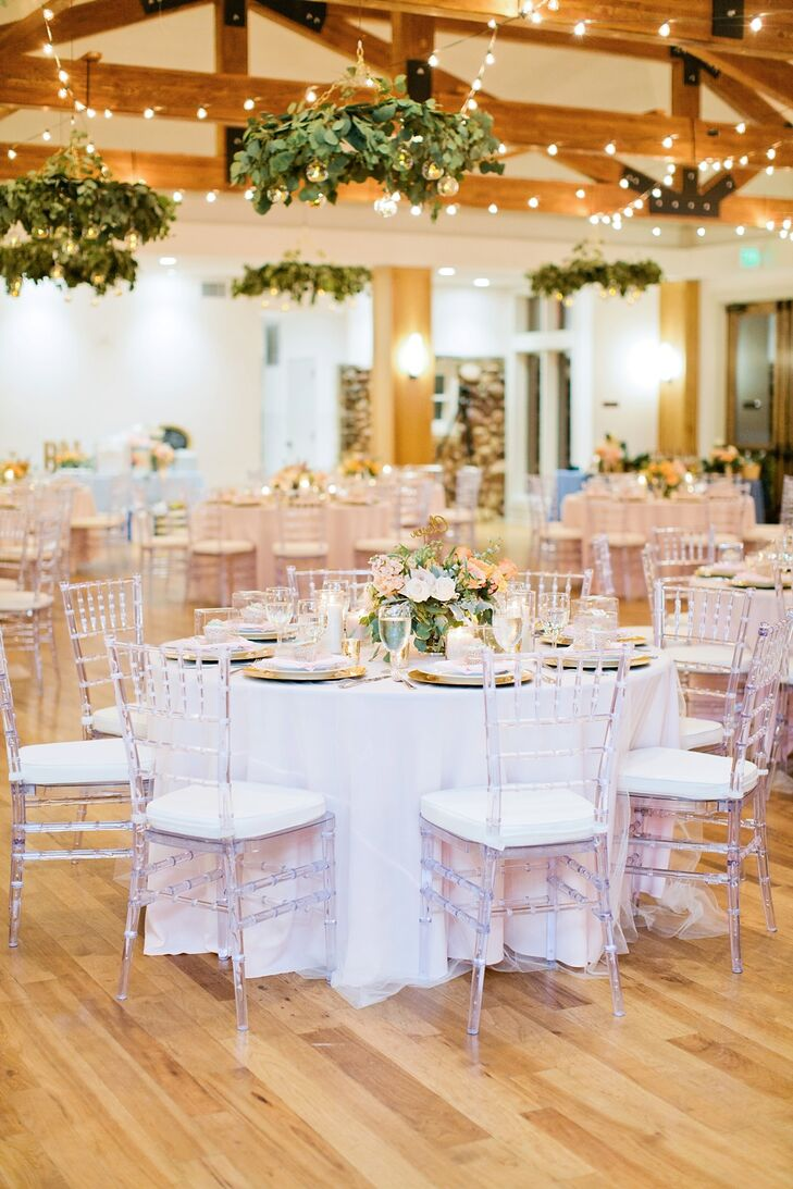 Round tables were decorated with blush pink tablecloths, overlayed with off-white crinoline. Chairs were crystal ghost chairs with white cushions. The centerpieces, naturally, were arrangements of garden flowers.