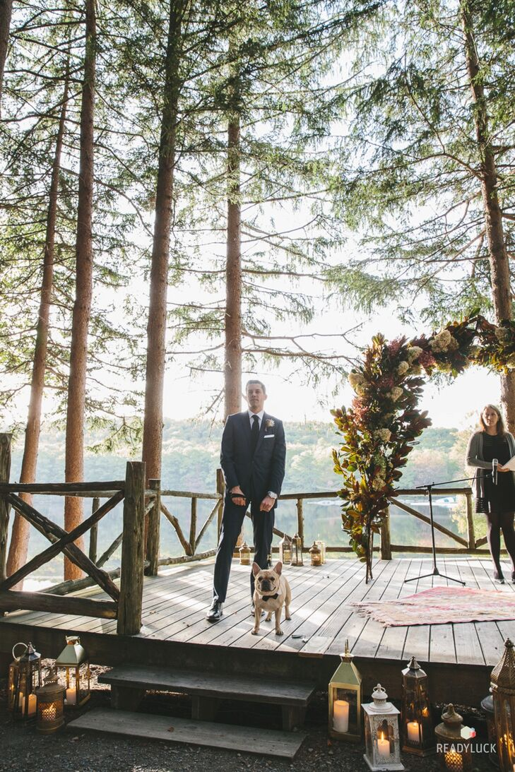 """Atticus, the couple's French bulldog, was waiting at the end of the aisle with Geoff, as Amy walked down the aisle. """"He was a happy spectator during the ceremony,"""" Amy says."""