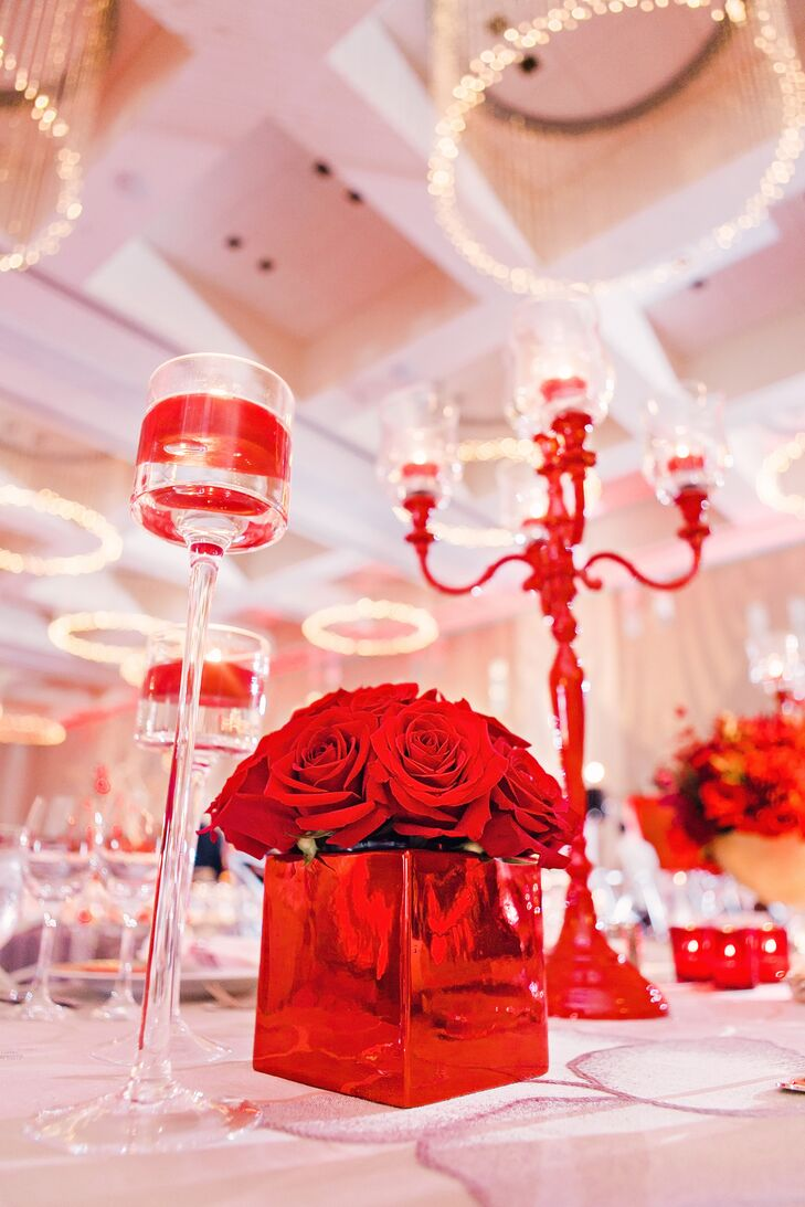 Centerpieces consisted of red hanging amaranthus, red roses, red spray roses, red leucodendron, red cymbid orchids, red makara orchids and more.