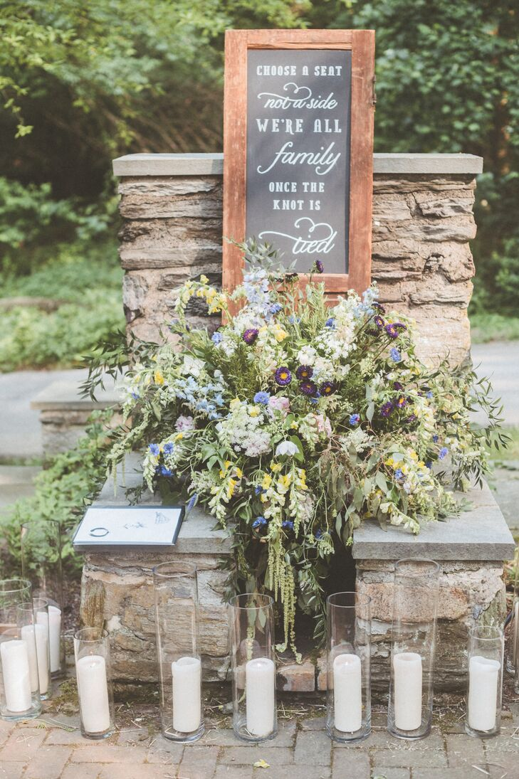 To mirror the natural beauty of the setting, the couple—with the help of Beautiful Bloom Events—decorated the expansive property with arrangements of loosely arranged wildflowers. The bouquets had a just-picked quality that called to mind carefree summer days spent in the countryside, while lending the decor a note of bohemian romance.