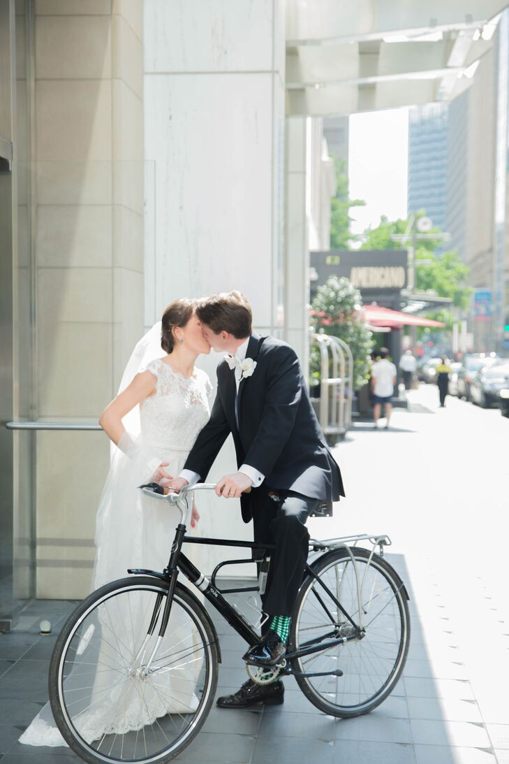 The groom wore a classic black tuxedo with funky green socks.