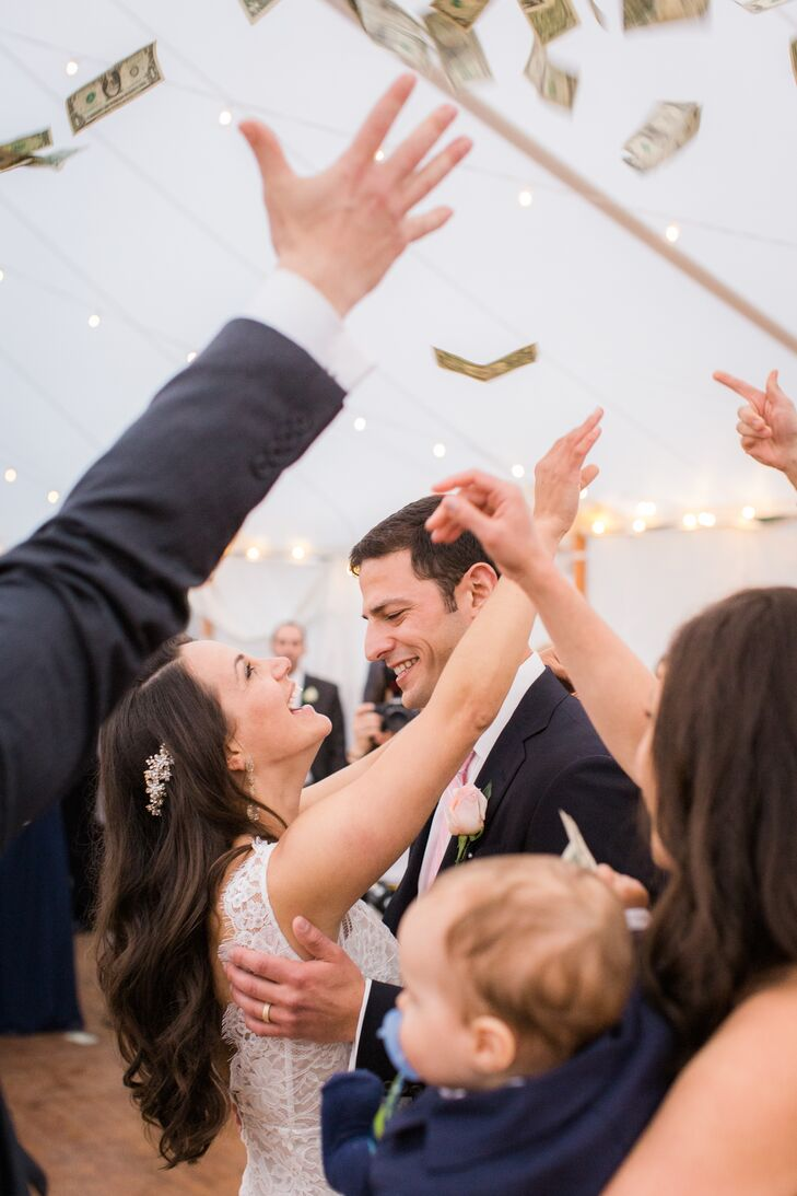 Nicole and Jeremy made sure to honor Nicole's Greek heritage by including some of the country's traditional music and customs, such as the reception money dance.
