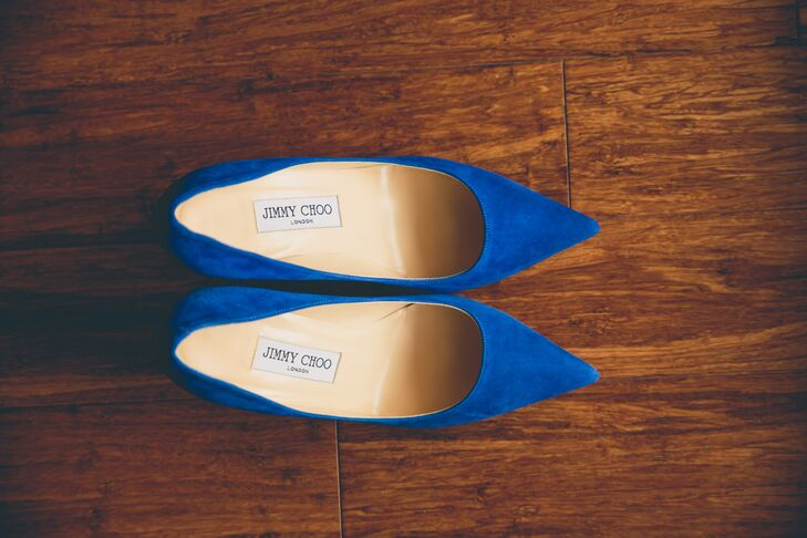 """My shoes were royal blue Jimmy Choo, which I am in love with,"" Kristin says. ""The shoes matched well with the Dessy bridesmaid dresses in shades of blue."""
