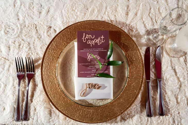 """To tie in the garden part of the theme, we completed each setting with a piece of greenery and a gold-painted wooden laser-cut name for each guest to take home,"" Amanda says."