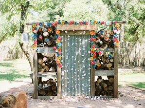 Woodshed Altar Covered with Bright Flowers