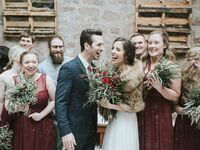 wedding couple with wedding party in snow
