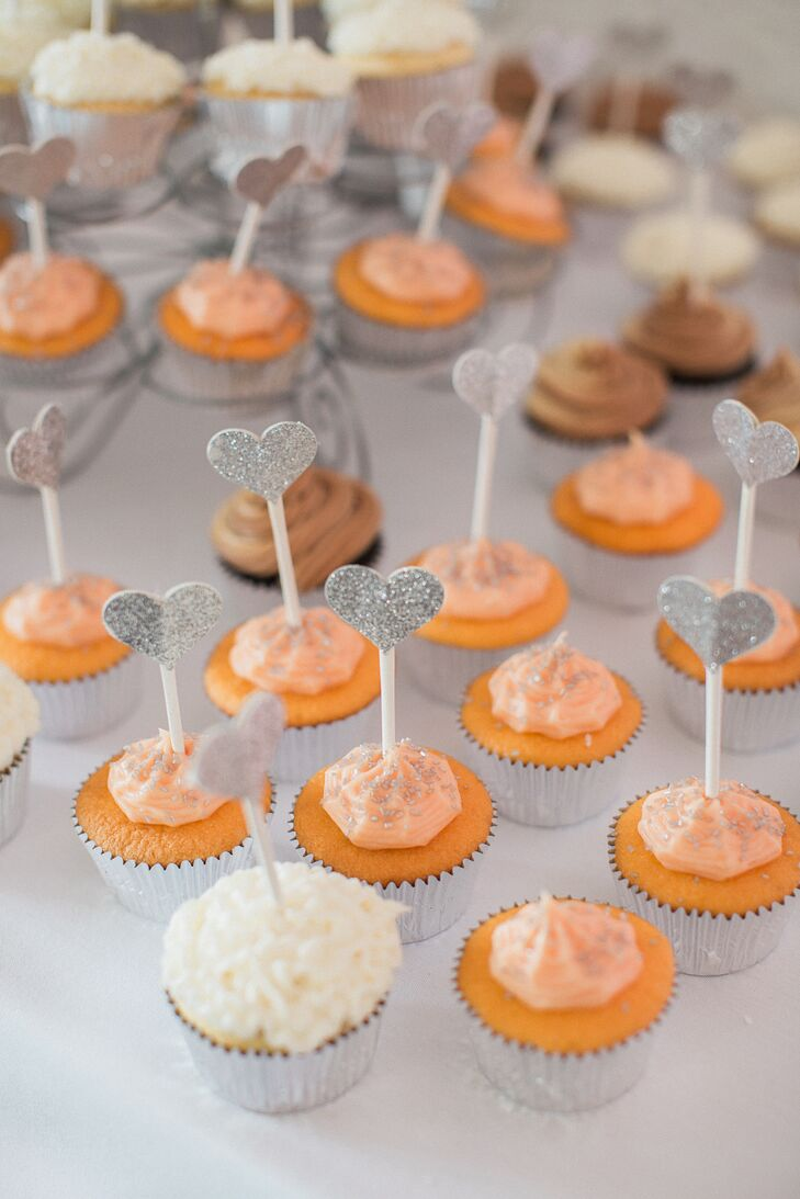 Amber's grandmother baked these cupcakes with sparkly heart-shaped toppers, in keeping with the wedding's palette.