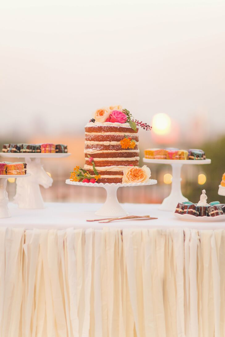 A multi-layer naked cake was the centerpiece of the dessert table. Other sweets, including petit fours in a variety of flavors, surrounded the confection.