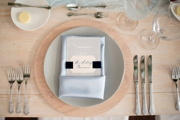 Modern, Formal Place Setting with Wood Charger, Gray Plate and Light Blue Napkin