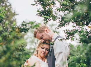 Ashlee McDearmon (27 and a program coordinator) and Jon Ewing (30 and a mechanic) had an intimate, vintage-inspired wedding with only their nearest an