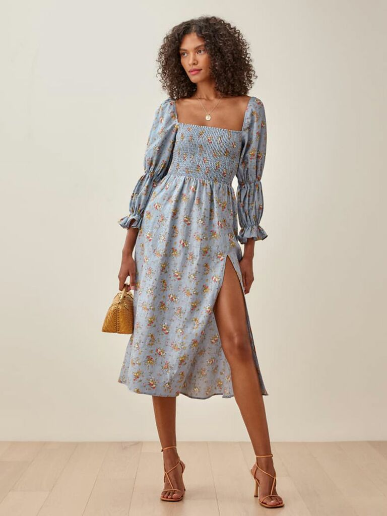 Blue cottagecore midi dress with smocked bodice and double puff sleeves
