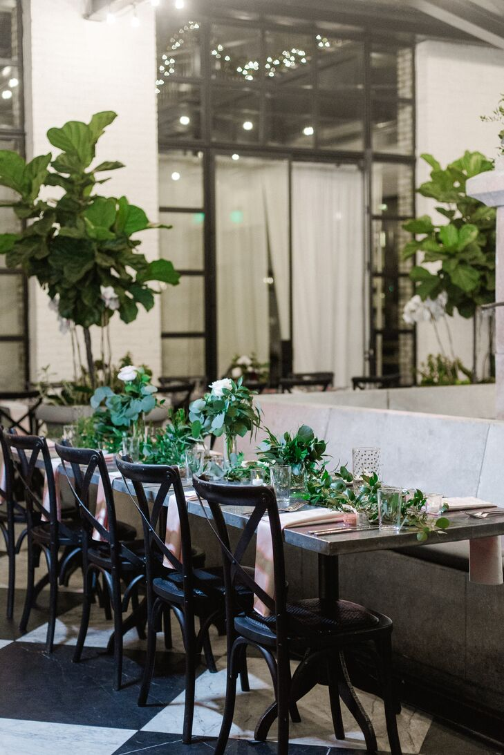 Reception Space with Cross-Back Chairs and Greenery