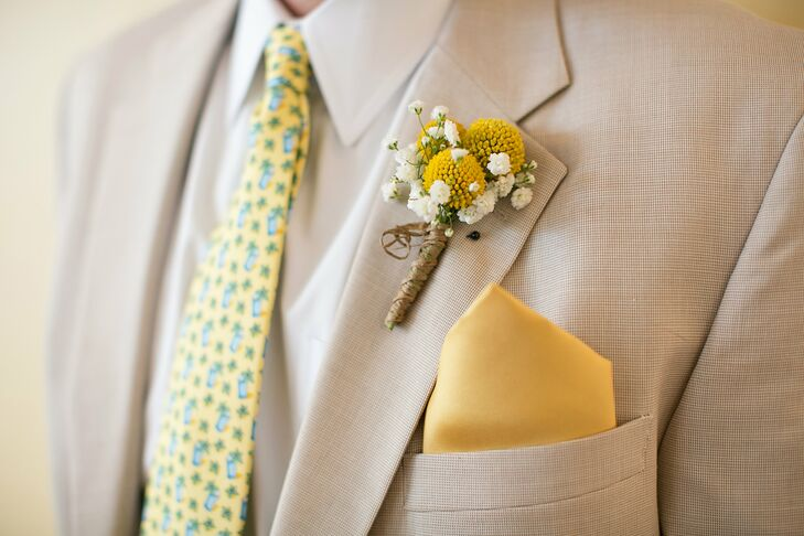 A fun craspedia boutonniere popped against Dryw's lapel.