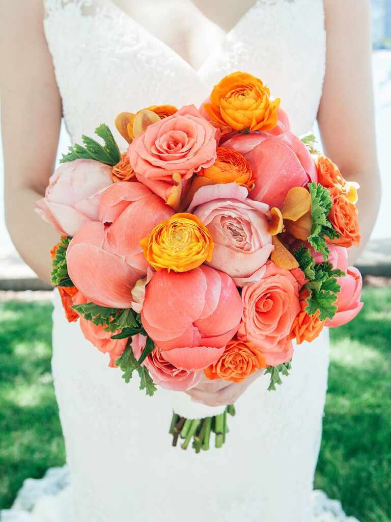 Bright wedding bouquet with roses, ranunculus and peonies