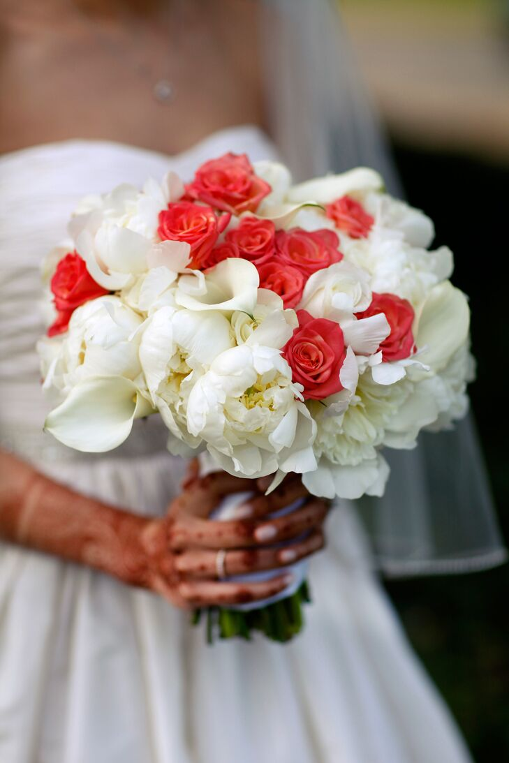 Kaveri carried a bouquet of white peonies, white calla lilies and coral roses. She had henna on her hands for her wedding day.
