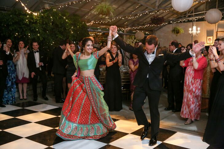 At her reception, Kaveri danced the night away in a teal green and coral sari.