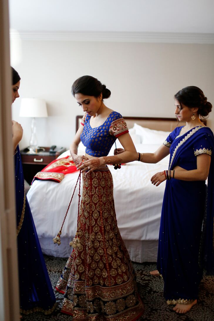Kaveri wore a stunning red and royal blue sari with gold embroidery for her Hindu ceremony.