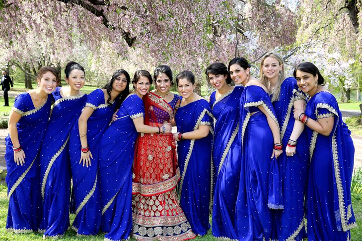 Kaveri's bridesmaids wore royal blue saris with gold trim that beautifully complemented her wedding sari.
