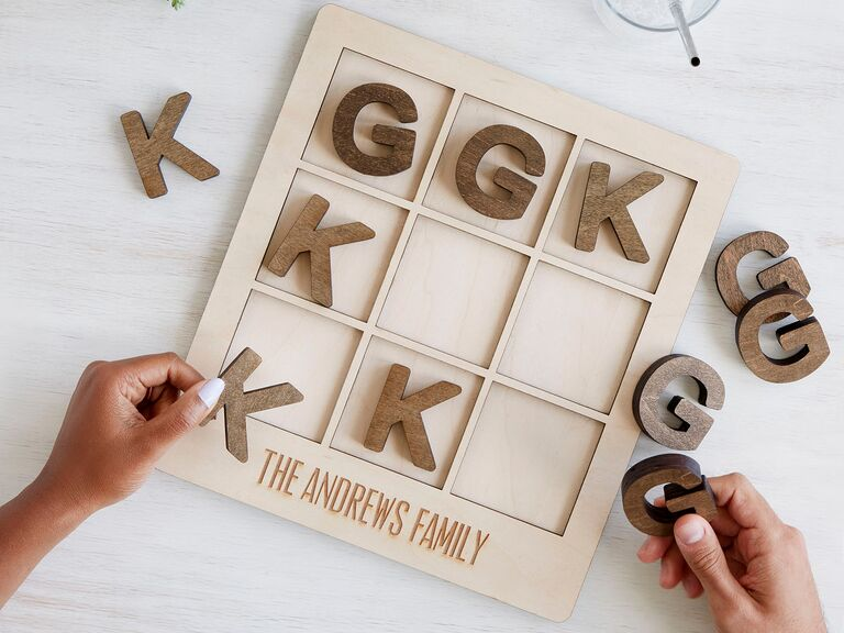 Couple playing custom wooden tic-tac-toe game