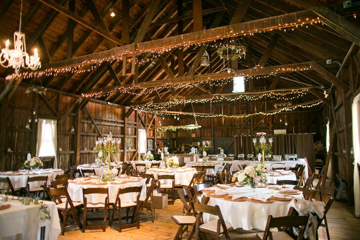 """""""I had always dreamed of a barn wedding,"""" Kristen says. After the couple moved from North Carolina to New Jersey, she did a ton of research and found Rode's Barn in Swedesboro, New Jersey. Kristen and Will highlighted its exposed wood walls and high ceilings with simple string lights and sweet chandeliers covered in greenery."""