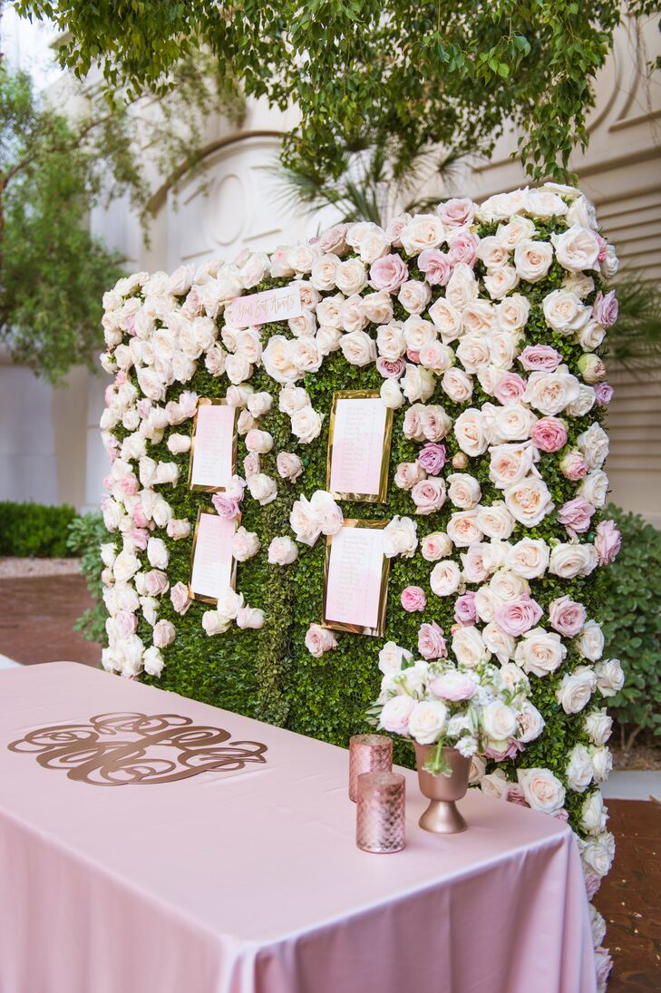 At Ethel and Jonathan's reception at the Four Seasons in Las Vegas, Nevada, guests found their names and seating assignments on an elaborate flower wall covered with blush and ivory roses.