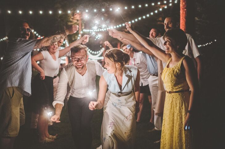 At the end of the evening, Caroline and Michael exited under a canopy of bistro lights and brightly lit sparklers waved by their family members and friends.