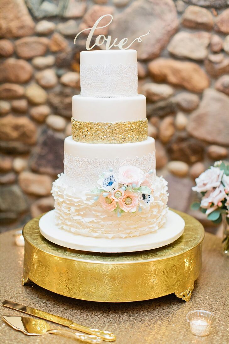 "The four-tier cake featured a layer of Italian cream, decadent chocolate, poppy seed and another layer of Italian cream, decorated in icing that resembled flowers, lace eyelets (to match Brittany's dress) and gold sequins. The ""love"" cake topper was ordered on Etsy."