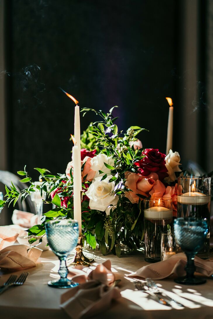 Taper Candles and Moody Floral Centerpieces