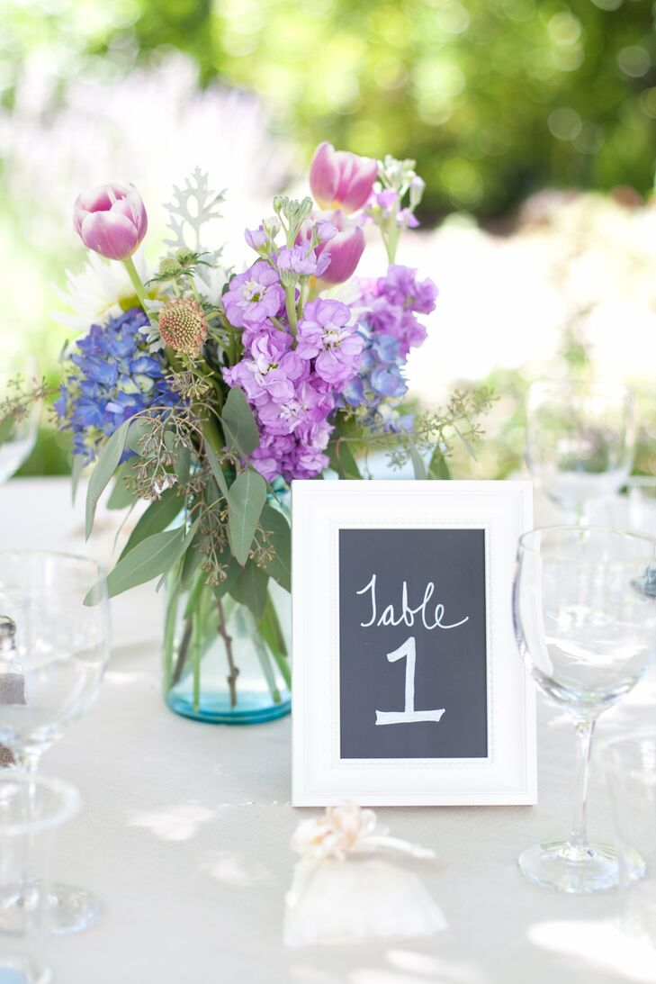 Blue vases held small arrangements of tulips, snapdragons and hydrangeas. The mix had a fresh just-picked feel.