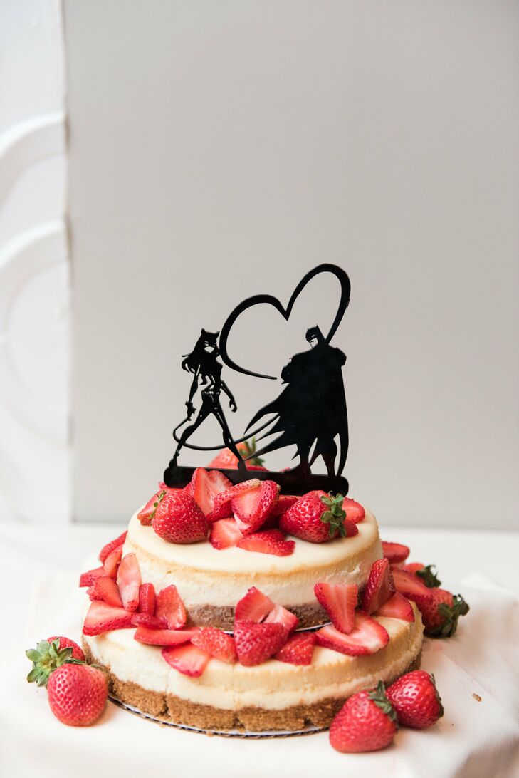 Sally and Danny showed their fun-loving personalities with a superhero cake topper of Batman's and Catwoman's silhouettes.