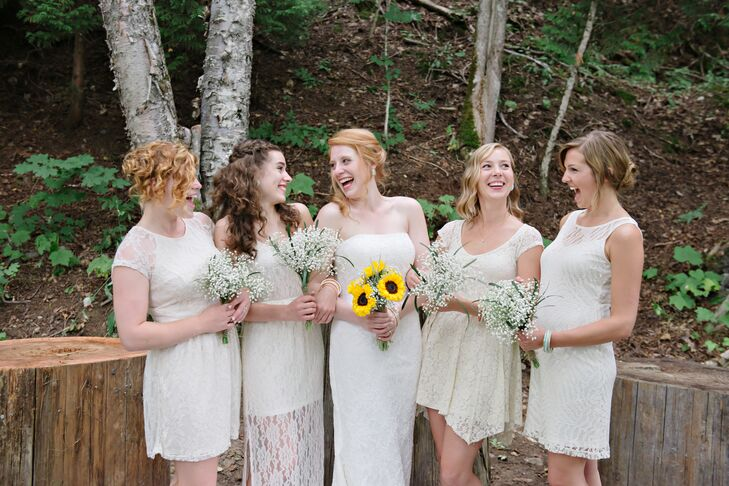 Emilie let her bridesmaids choose their own dresses for the wedding, each in a soft cream-colored hue and lace fabric.