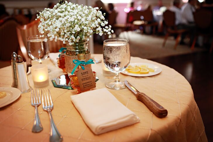 Centerpieces at the reception were decorated with mason jars that were filled with baby's breath for a rustic touch.