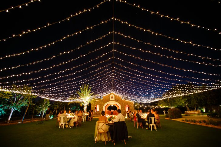 "The newlyweds' dinner reception was held in the Flora Farm's mango grove under a tent of string lights. ""The entire farm was glowing, and we ate and drank under the stars,"" the bride says. Taylor and Cory dined at a romantic sweetheart table that was embellished with greenery, pink peonies, candles and lanterns. ""It might have been the dreamiest table ever!"""