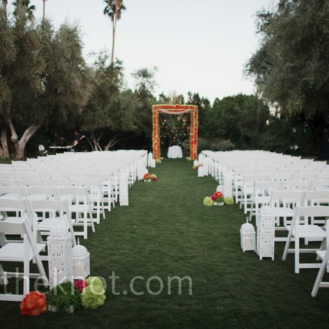 Crisp white Moroccan lanterns and colorful flower balls dotted the grassy aisle.