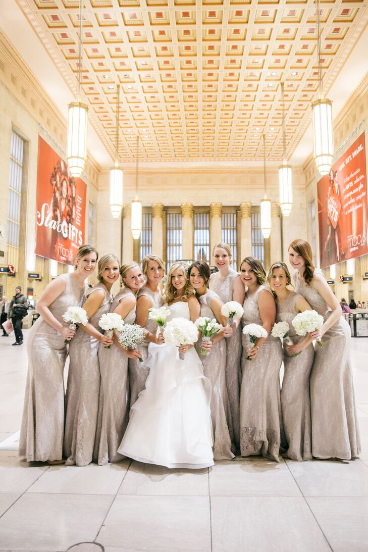 The bridesmaids wore floor length dresses in taupe by Watters. The wedding party had a photo session in Philadelphia's iconic 30th Street Station.