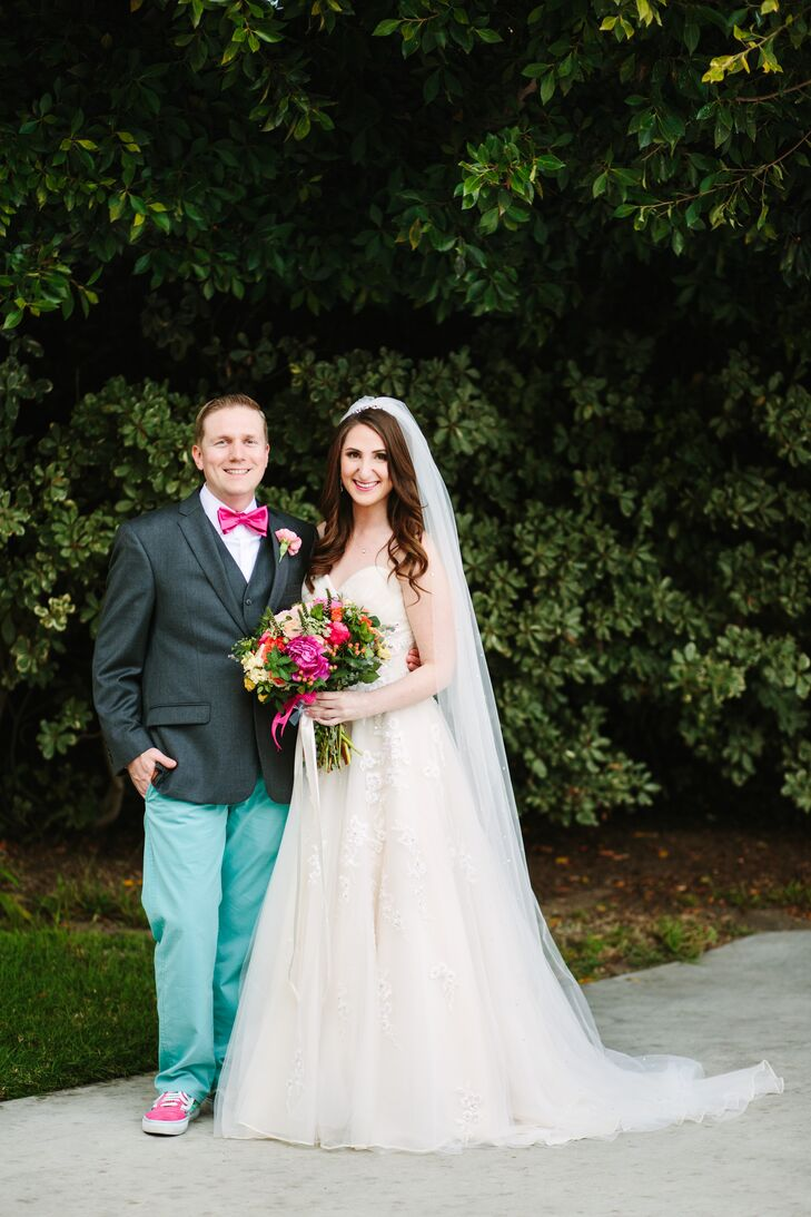 """We were most inspired by the look of our venue and wanted to bring lots of color into the reception hall to match the beautiful ocean vistas,"" says Thadd, who wore teal pants and a pink bow tie to echo the vibrant colors in the florals and bridesmaid gowns."