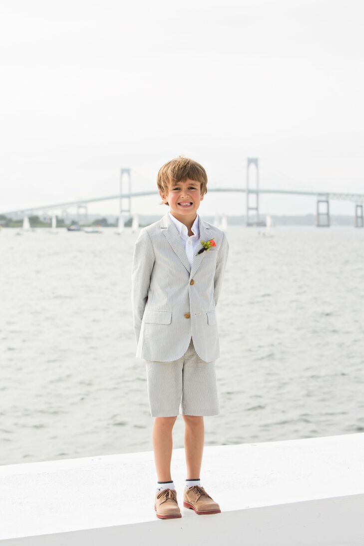 A pinstripped suit brought a summery air to the ringbearer's look.